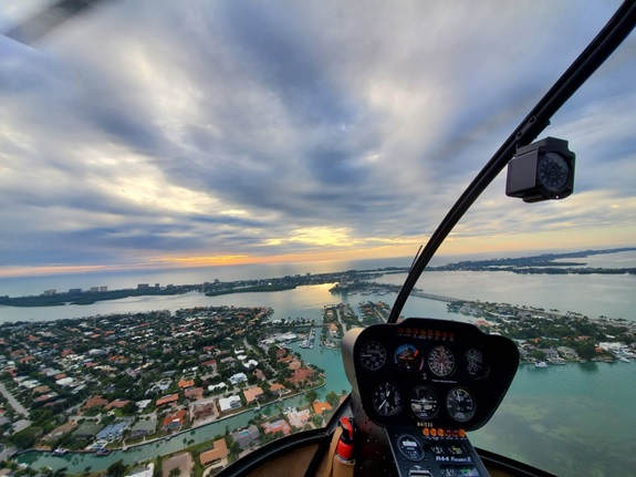 The perspective from the passenger seat during an aerial helicopter tour in Florida.
