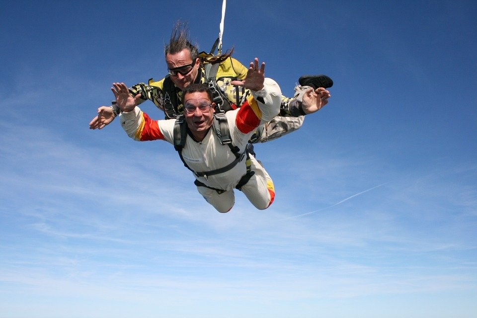 A man skydiving with an instructor