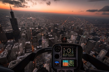 A view of NYC at sunset from a helicopter