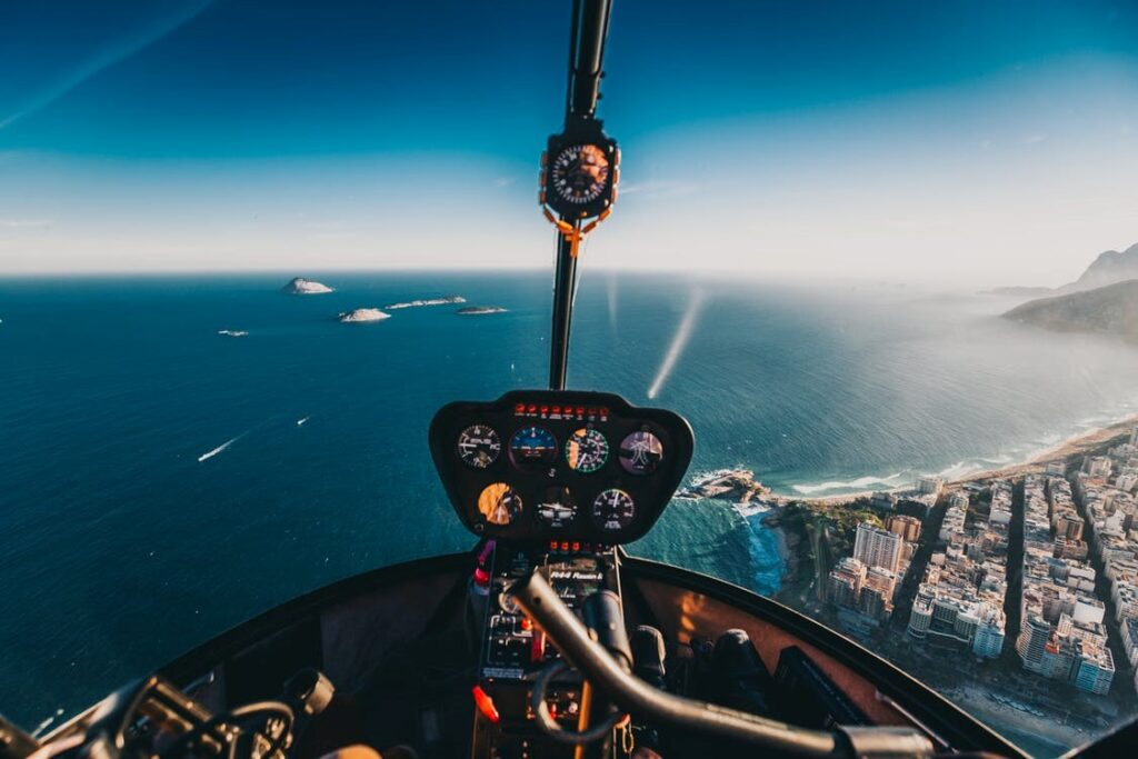 An aerial view of a city through a helicopter