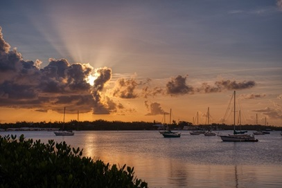 Ships at sea during sunset