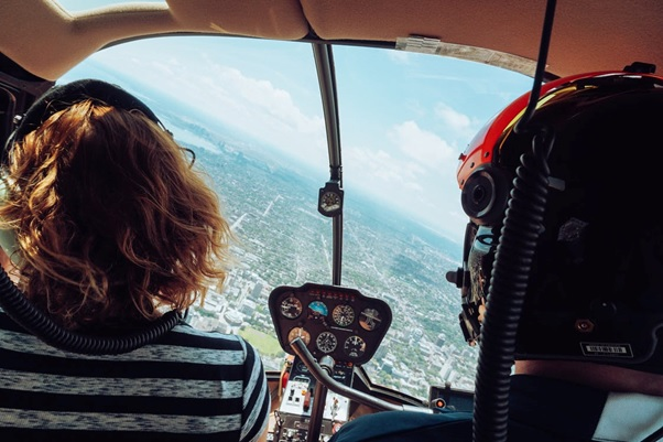 A couple enjoying a helicopter tour
