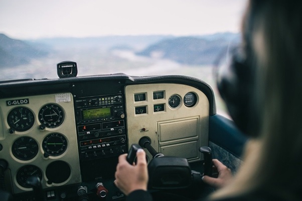 A pilot in a helicopter cockpit